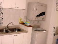 Kitchen with washer, dryer, garbage chute. Burlington Square Residence, Singapore