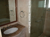 Master bathroom with marble walls, shower stall and long bath