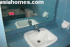 Original wall tiles and bath tubs and sinks of Horizon Towers are deep blue