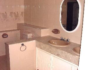 Fontana Hts bathroom - original coloured baths not appealing to Caucasians.