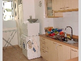Bright kitchen but small maid's room.