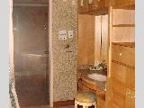 Master bathroom with walk in closet, dresser & jacuzzi bath.