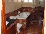 A typical modern marble-tiled bathroom