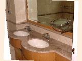 Burgundy Drive's luxurious marble-tiled master bathroom.