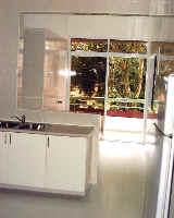 Villa delle Rose upper maisonette. Remodelled kitchen, big utility area and greenery.