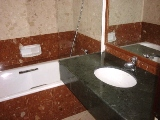 Mera Gardens marble clad master bathroom