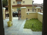 Mera Gardens terrace house's car porch