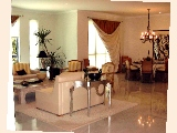 Spacious living and dining areas in the 3200 sq. ft apartment.