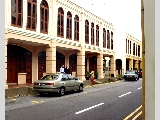 Quiet Niven Road with pretty shophomes.