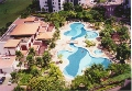 Parc Oasis: Resort pools and lush greenery