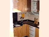 River Place: Granite counter top and white kitchen appliances